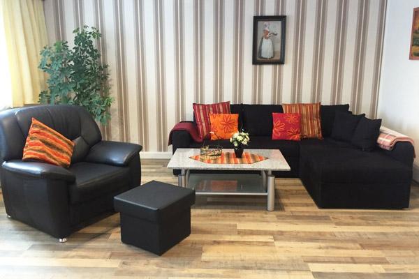 Ferienwohnung Lilienstein Rosengasse - Wohnbereich mit Sofa